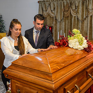 Mourners in front of a casket