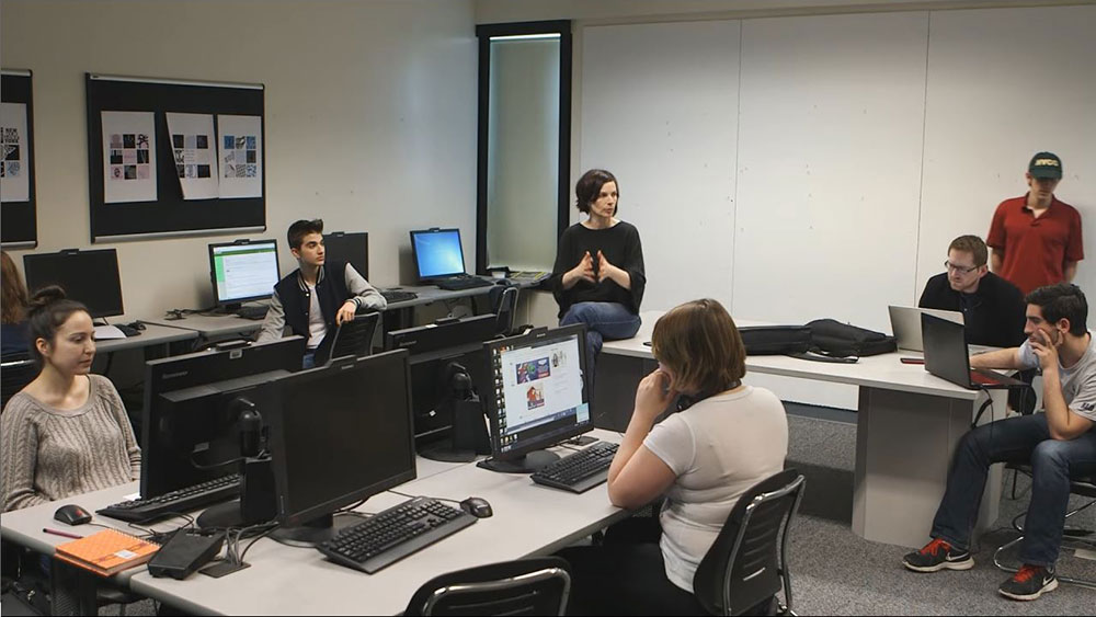 Students and instructor in digital media computer lab