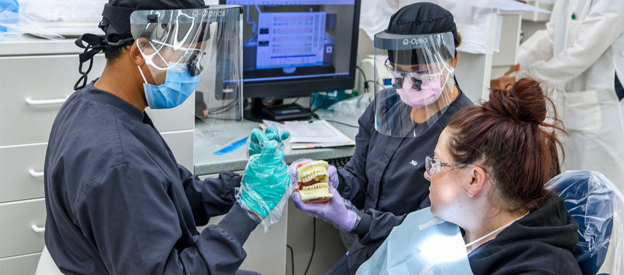 Dental hygiene student working on a patient