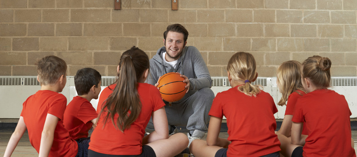 A coach with his basketball players