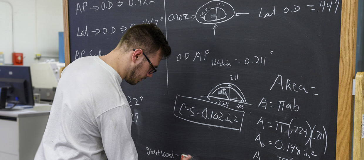 Student working on problem at chalkboard