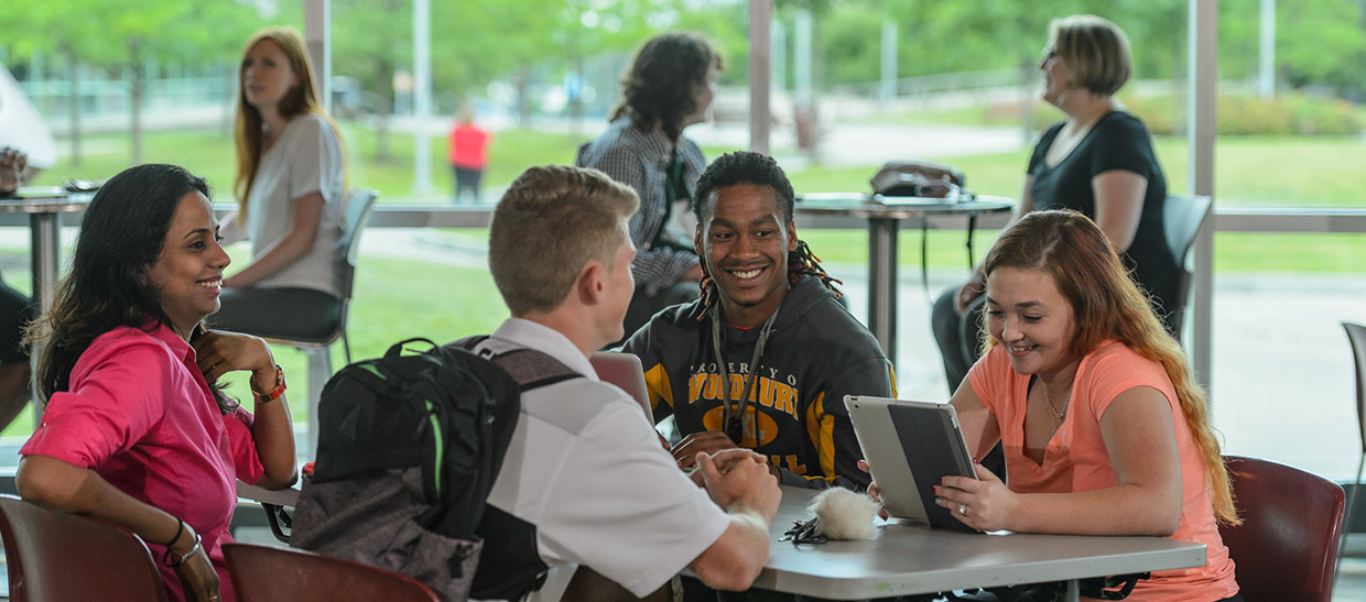 Students sitting at a table in the campus center