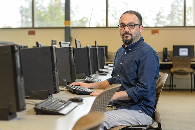 Saad M. in a computer lab