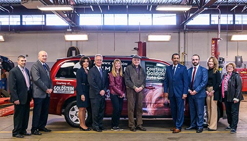 HVCC officials and Goldstein Auto Group management pose with donated vehicle